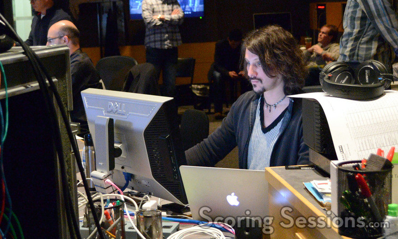 Digital recordist Adam Olmstead surrounded by his workstation