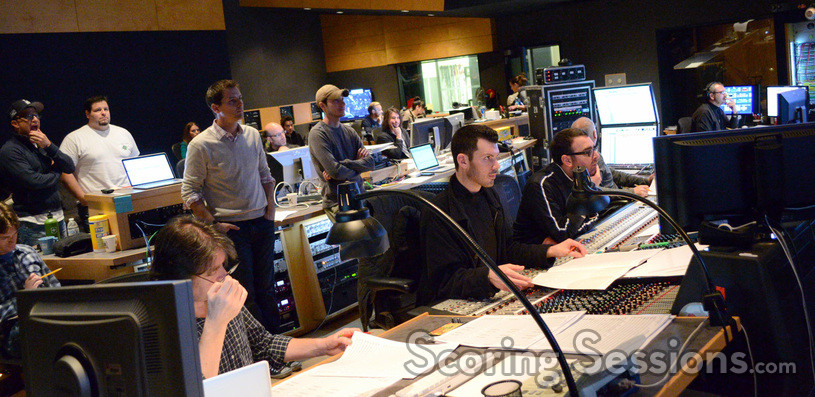 The booth watches the playback as John Paesano's score to <i>The Maze Runner</i> is recorded