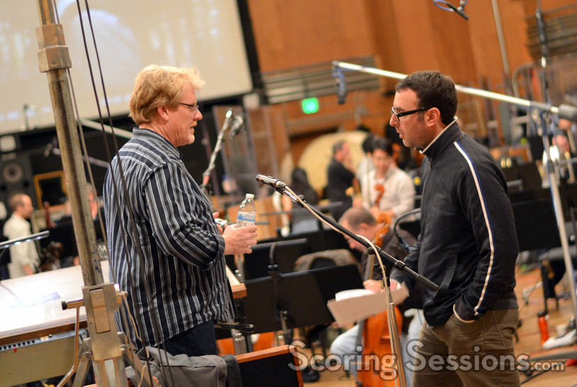 Conductor Pete Anthony and composer John Paesano discuss a cue between takes