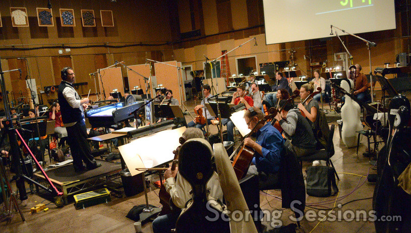 Composer Chris Lennertz and the orchestra stand by to record