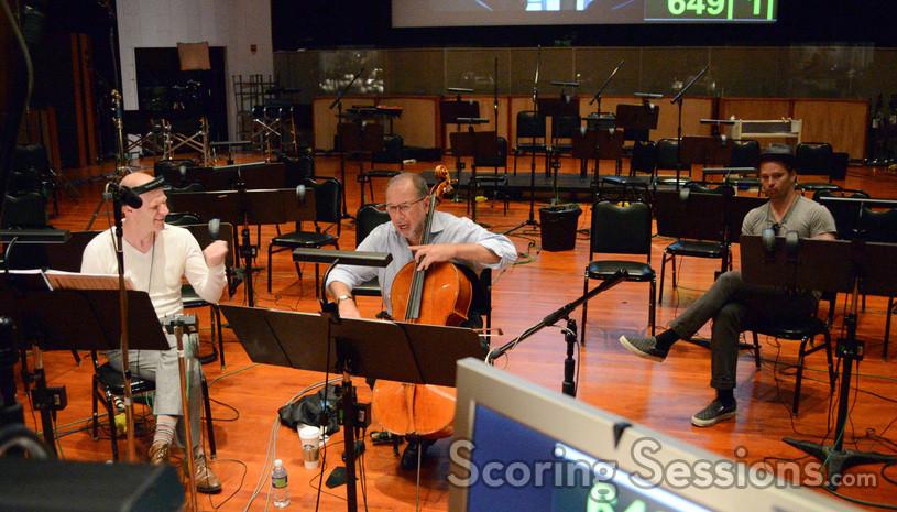 Composer Tom Holkenborg, solo cellist Steve Erdody and director Scott Cooper