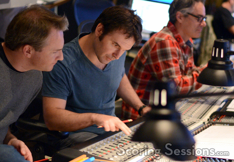 Additional arrangers Marcus Trumpp and Brandon Roberts adjust levels as composer Marco Beltrami listens to the mix