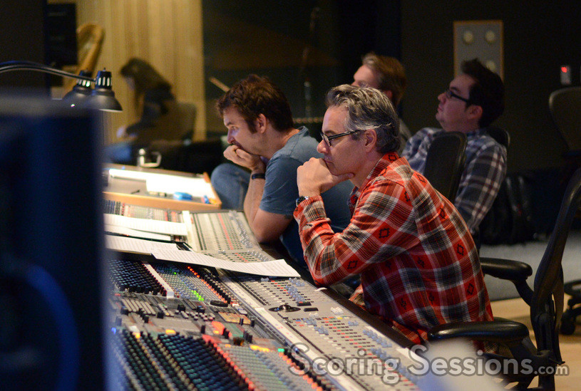 Additional arrangers Brandon Roberts and Miles Hankins listen to a cue with composer Marco Beltrami