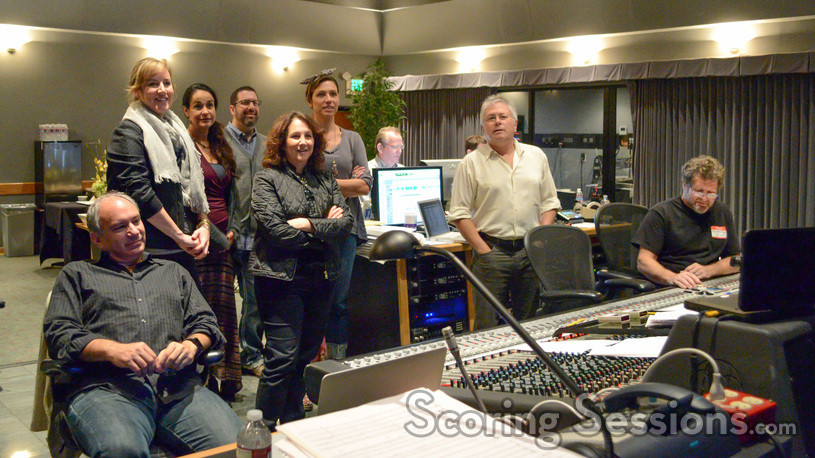 The music team watches playback with Alan Menken and Christopher Lennertz's score