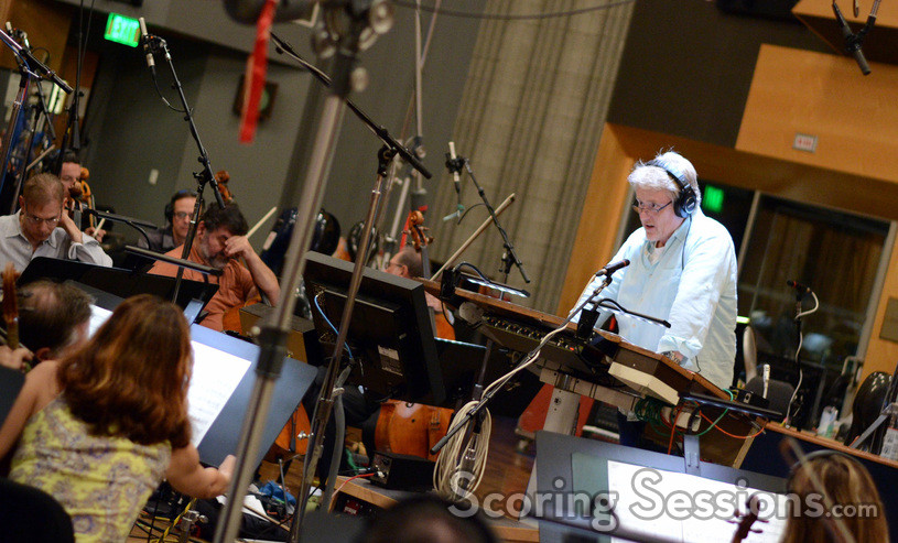 Conductor and orchestrator Pete Anthony gives feedback to the orchestra
