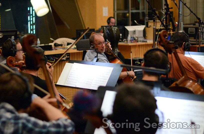 Principal cellist Steve Erdody discusses a cue with the section
