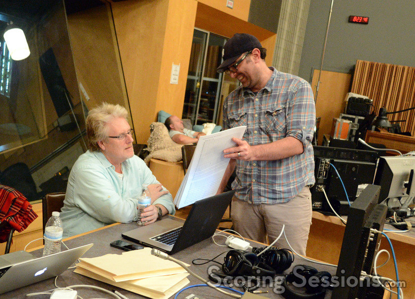 Composer John Paesano points out a moment in the score to conductor and orchestrator Pete Anthony