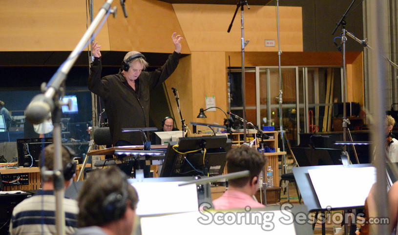Conductor Nick-Glennie Smith prepares to conduct a cue