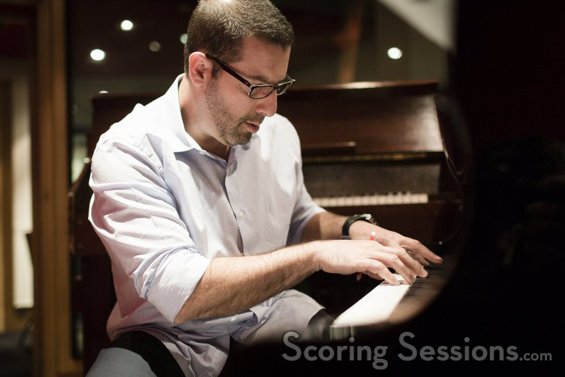Christopher Lennertz checks a cue on the piano