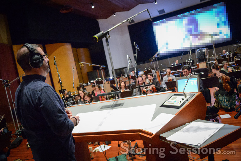 Composer/conductor Christopher Lennertz waits for the playback to be queued up