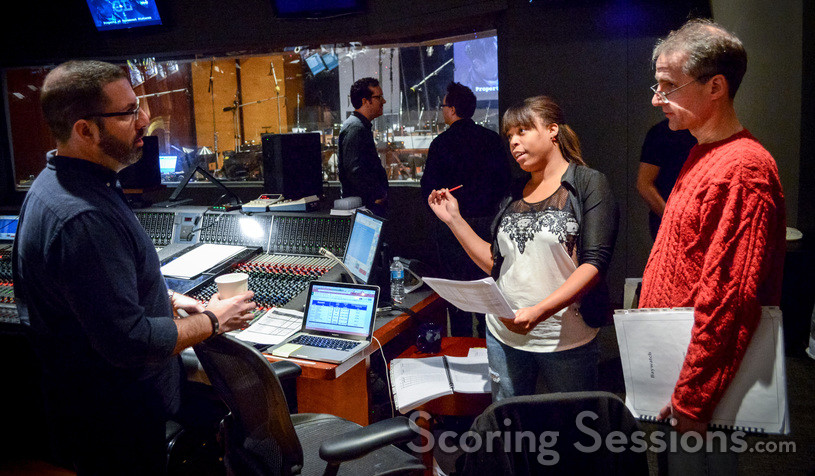 Score producer Dara Taylor chats with composer Christopher Lennertz (left) and orchestrator Andrew Kinney (right)