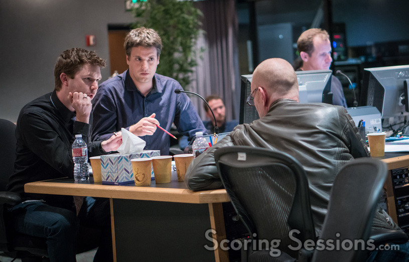 Composer Tom Holkenborg goes over a cue with orchestrators Jonathan Beard and Henri Wilkinson
