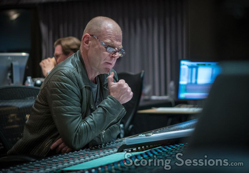 Composer Tom Holkenborg looks over his score