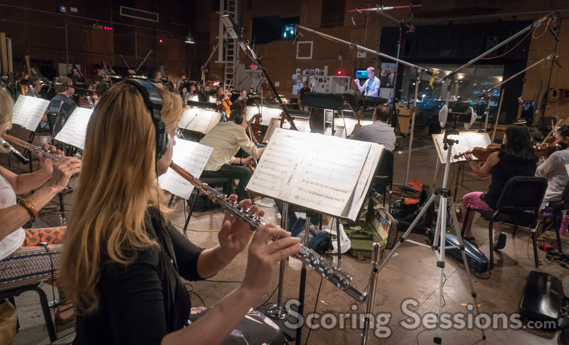The view from the woodwind section as composer Rolfe Kent conducts the orchestra