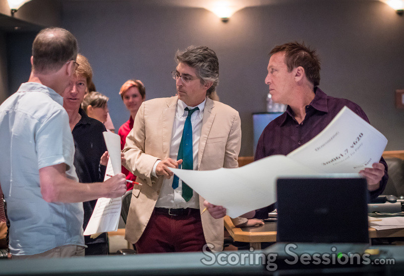 Composer Rolfe Kent talks with music editor Nick South, director Alexander Payne, and scoring mixer Greg Townley