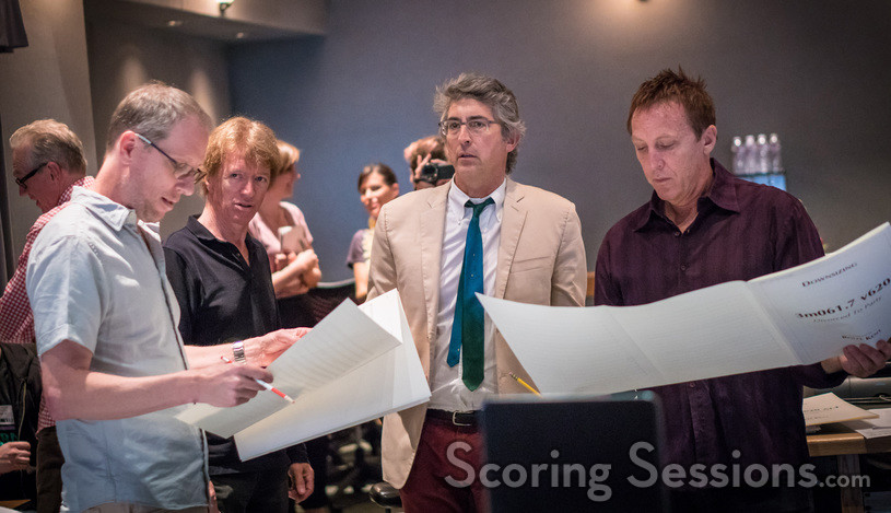 Composer Rolfe Kent (left) goes over a cue with music editor Nick South, director Alexander Payne, and scoring mixer Greg Townley