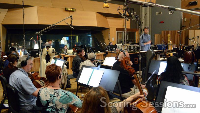 Composer Rob Simonsen talks with the cello section
