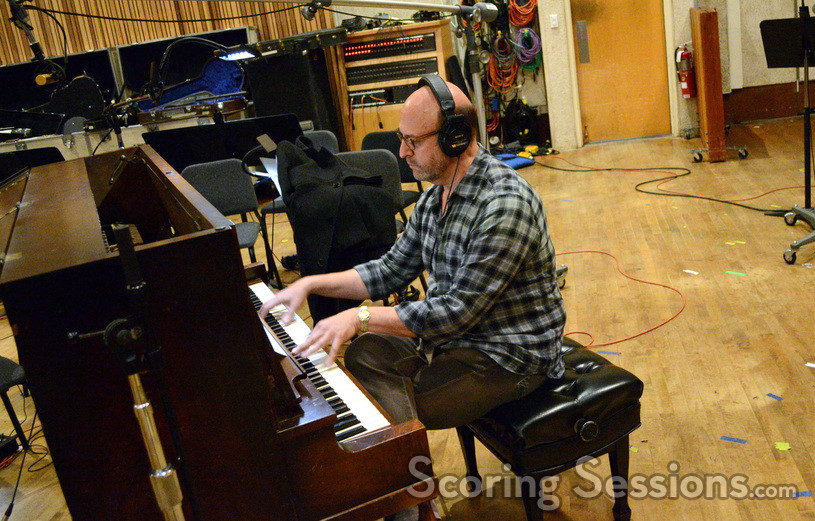 Randy Kerber performs on upright piano