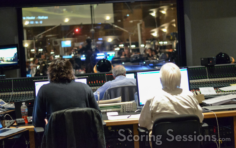 ProTools recordist Adam Olmstead, scoring mixer Dennis Sands, and music editor Tom Carlson watch composer Nathan Wang conduct the Hollywood Studio Symphony