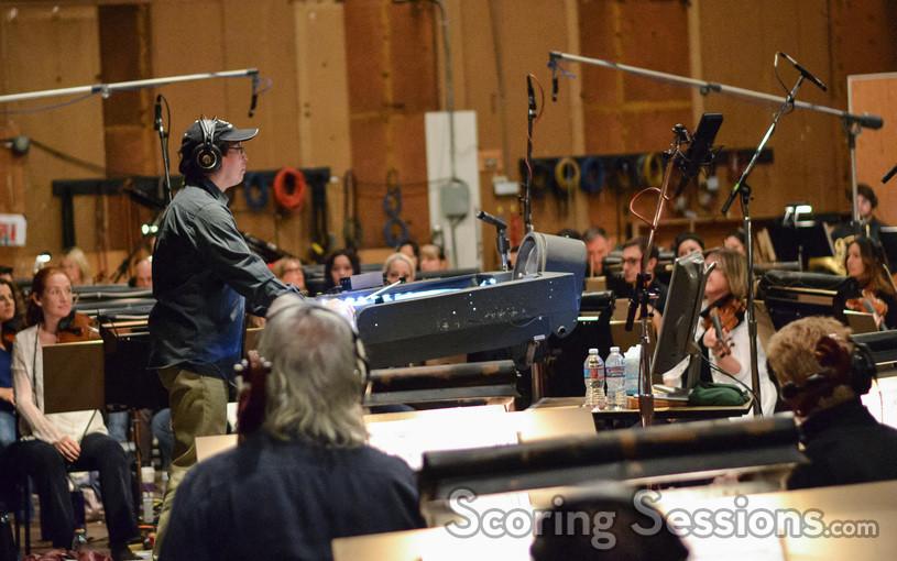 Composer/conductor Nathan Wang checks the playback