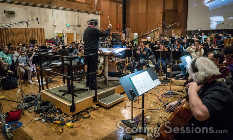 Composer Bruce Broughton conducts the orchestra