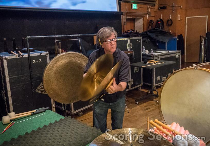 Percussionist Brian Kilgore plays the crash cymbals