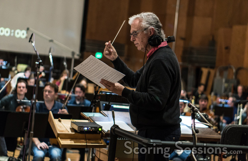 Composer Bruce Broughton goes over a cue at the podium