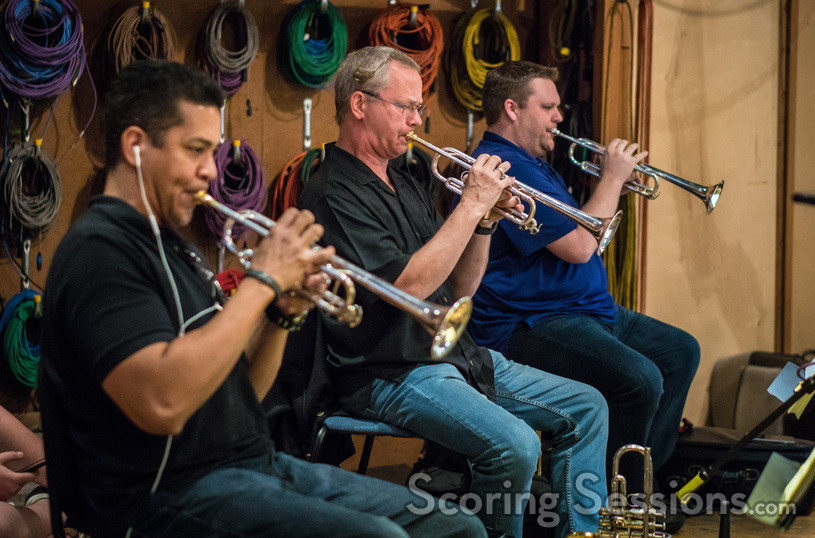 The trumpet section: Barry Perkins, Jon Lewis, and Rob Schaer
