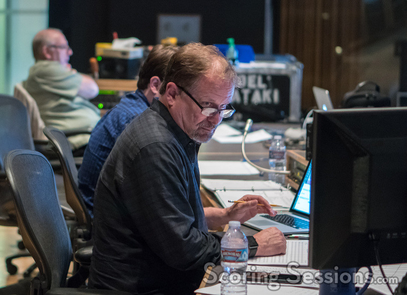 Music editor Stan Jones goes over the cue sheet