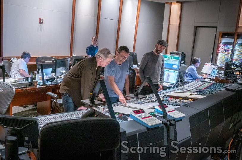 Conductor Nick Glennie-Smith, composer Rupert Gregson-Williams, and scoring mixer Jason La Rocca go over a cue