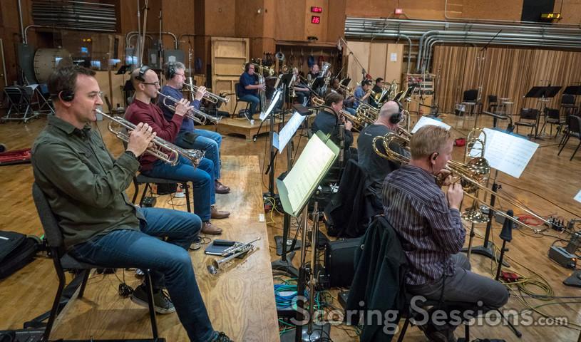 The trumpets and trombones perform on <em>The Darkest Minds</em>