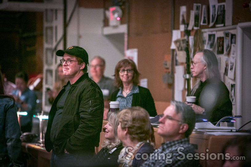Director/writer Brad Bird watches the orchestra perform