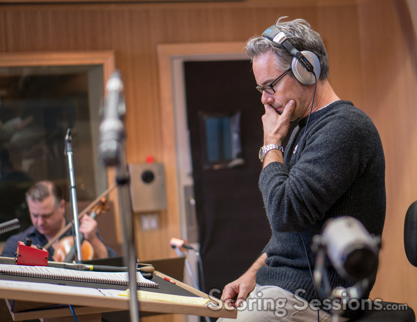 Composer Marco Beltrami contemplates a cue before he conducts it
