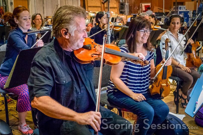 Concertmaster Bruce Dukov leads the violins