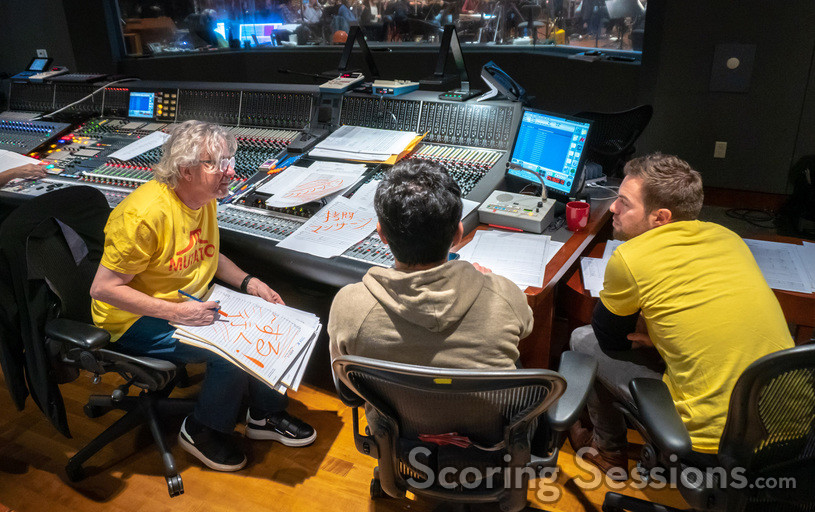 Composer Mark Mothersbaugh goes over a cue with additional music composers Wataru Hokoyama and Peter Seibert