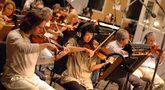 Violinist Charlie Bisharat and the string section