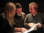 Director Andrew Adamson examines a cue with music editors Bryan Lawson and Adam Smalley