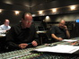 Music editor Nick Vidar, orchestrator Conrad Pope, and score mixer Dennis Sands