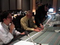 "Stage Engineer Ryan Robinson helps score mixer Dan Wallin figure out a problem as Michael Giacchino listens to a cue from ""The Karateguard"""