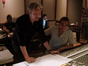 Brian Tyler and Joel Iwataki listen to a cue during playback