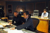 Brian Tyler and Joel Iwataki examine a cue as Tiffany Jones from Universal Studios and Technical Score Consultant Keith Power observe