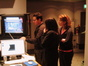 Director J.J. Abrams examines a change to a scene as editors Maryann Brandon and Mary Jo Markey look on