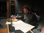 Composer Christophe Beck examines a cue