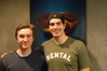 Sam Huntington and Brandon Routh in front of the <i>Superman Returns</i> poster