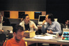 Director/writer Jieho Lee and composer Marcelo Zarvos discuss the score, while mixer Gustavo Borner (foreground) checks his notes