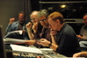 Ron Vermillion (music preparation), Edgardo Simone and Steve Bartek (orchestration) look on as Danny Elfman gives feedback on a cue
