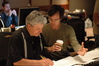 Tom Calderaro and composer Michael Andrews examine a cue