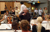 Concertmaster Endre Granat suggests a change to the violin section