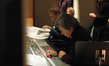 Score mixer, Bobby Fernandez, at the mixing board of Warner Brothers Eastwood Scoring Stage.