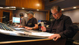 Stage recordist Aaron Walk, scoring mixer Dan Wallin, and composer Chris Tilton listen to a cue